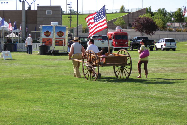 Families were taken on pull-cart rides at the Wild West Roundup at the Utah Cultural Celebration Center on July 16. –Travis Barton