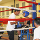 A coach speaks with his boxer inbetween rounds at the Pete Suazo Boxing Invitational on Aug. 19. Boxing gyms from Orem and Ogden to Colorado and California brought their boxers to compete. –Travis Barton