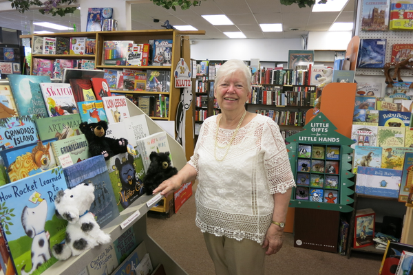 Betsy Rider, in the children's section of her store—one of her favorites.