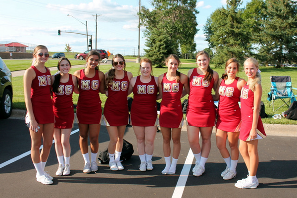 Cheerleaders before the Maple Grove Senior High and Osseo Senior High football game Sept. 1, 2016. (photo by Doug Erlien)