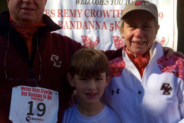 Welles McDevitt with Mr. and Mrs. Crowther, again at the annual Red Bandana 5K at Boston College