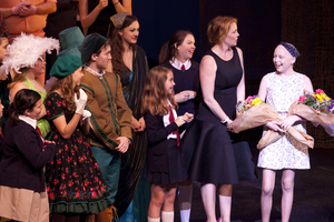 Ella is greeted by Erica Peterman and her friends and cast-mates on stage