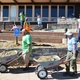 NPLD volunteers prepare soil around the Lehman Caves Visitor Center's new accessibility ramp for landscaping.