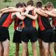 Varsity runners on the boys team gather for a quick pre-race pep talk at the Lakeview Invitational earlier this season. Brighton's boys team is putting in more than 50 miles of training each week. (Brighton High School cross-country)