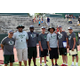 The 2016 coaching staff poses for a group photo during an afternoon practice. Head coach Cazzie Brown (third left) has high expectations for how his players are to act both on and off the field and, along with his fellow coaching staff, is eager to set an example of what the Hillcrest football program represents. (hillcresthuskiesfooball.com)
