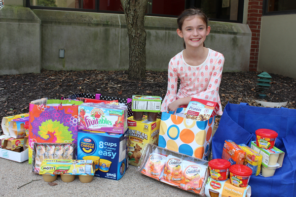 Second-Grader Donates Hundreds of Items to Backpack Initiative