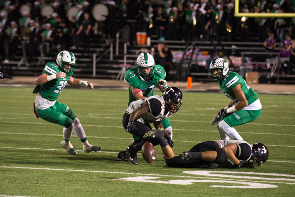 Linebacker John Miscoll (47) forces a Euless Trinity fumble as the Dragons defeated rival Euless Trinity by a score of 42-28 at Dragon Stadium on September 30, 2016. Photo by SnappedDragons.com/S. Johnson.