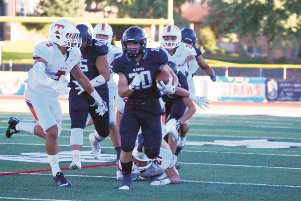 Senior team captain Joshua Davis running against Timpview earlier this season. (Alta High School Football)