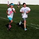 South Jordan Elementary fourth-grade students run around the school field ahead of their principal, Ken Westwood, to help raise funds for school PTA activities.