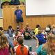 Ted Ligety, the youngest American to claim an Olympic Gold Medal in Alpine skiing, shares the story of how he became a professional athlete to children at the YMCA Community Family Center in Taylorsville. (Tori La Rue/City Journals)