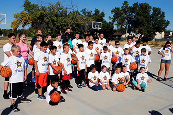 Taylorsville Jr. Jazz players pose for a photo at a basketball camp facilitated by the Salt Lake City Stars (Billy Swartzfager)