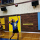 Ginger Lei Wright serves the volleyball to her teammates as they practice before a game on Sept. 13. (Tori La Rue/City Journals)