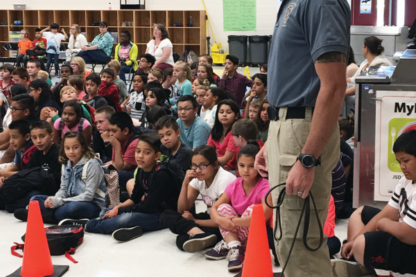 Two K9s visited Heartland Elementary School as part of a safety assembly on Sept. 15. (Tori La Rue/City Journals)