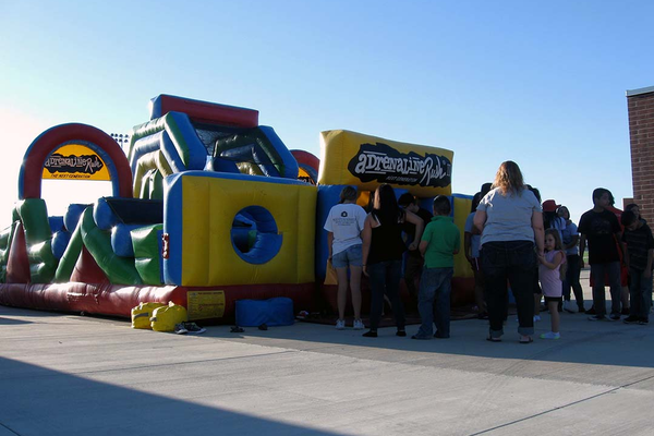 Bounce houses were part of the festivities at the Granger Carnival at Granger High School where people could race one another through the bounce house. (Travis Barton/City Journals)