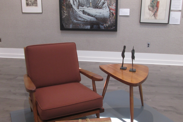 A chair, stool and table by George Nakashima, with 'Emerson (Aftermath Series),' by Vik Muniz.