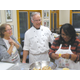 Mary Ellen and Chef Tim look on as Kisha folds and seals a pork pot sticker.