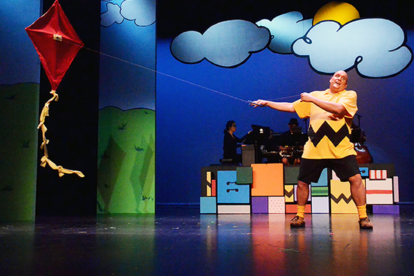 Charlie Brown, played by Josh Little, finally is able to fly his kite. (Karla Marsden/Sandy Arts Guild)