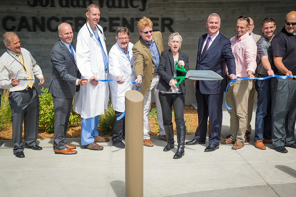 Anne Kieryn, a Jordan Valley surgical specialist, cuts a ceremonial ribbon at the Jordan Valley Cancer Center on Sept. 2, symbolizing the center's opening. (Kyle Rathjen/Fuel Marketing)
