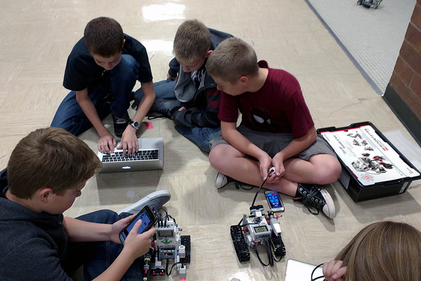 Robots are programmed by school laptops or controlled by apps on the students' phones. (Jet Burnham/City Journals)