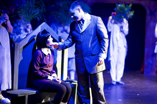 "Ryan Hoskins (Gomez) sings to Brynnly Bosworth (Wednesday) during the second act of ""The Addams Family"". (Dustin Bolt and Amy Bosworth/Midvale Main Street Theatre)"