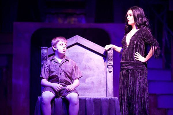 "Maggie Goertzen (Morticia) puts Thomas Middleton (Pugsley) to bed in ""The Addams Family"" performed at the Midvale Main Street Theatre. (Dustin Bolt and Amy Bosworth/Midvale Main Street Theatre)"
