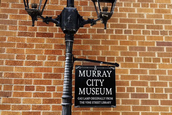 Sign for the Murray City Museum on a gas lamp originally from the Vine Street Library. (Alisha Soeken/City Journals)