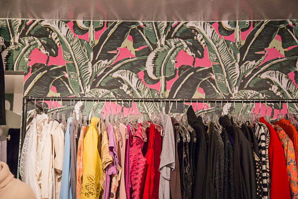 Interior of The White Elephant Exchange, displaying the vibrant palm tree wallpaper.