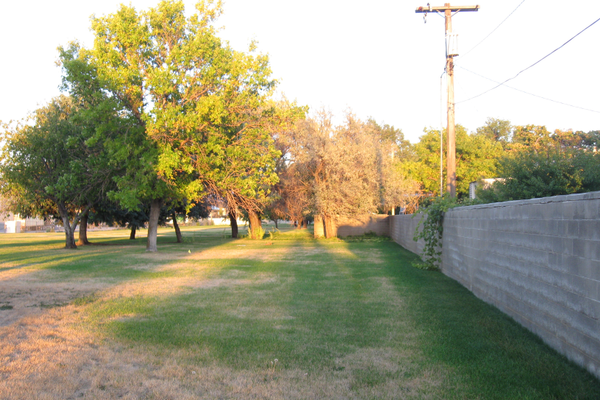 The buffer zone of 70 feet between neighborhood houses and the warehouse that was established in 1985. That zone will decrease to 50 feet after a compromise was found between Boart Longyear, the incoming company to the property and the neighborhood. (Travis Barton/City Journals)
