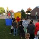 Neil Armstrong Academy students line up at the dunk tank to sink Principal Matt Goebel during the STEMfest on Oct. 11. (Travis Barton/City Journals)