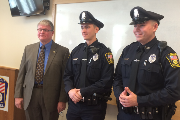 Dracut Police Chief Neil Ouellette welcomes new officers Connor Geoffroy and Kyle Donahue.