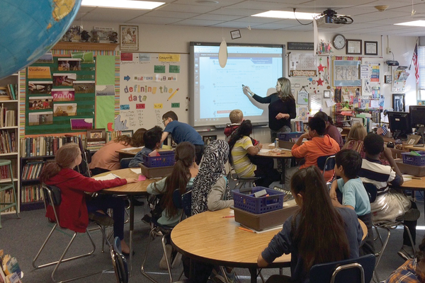 Johanna McMullin leads her sixth-grade class in reviewing the math lesson for the day. (Aspen Perry/City Journals)