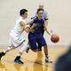 A player drives around an opponent last season (Kalle Robertson/Bingham High School)