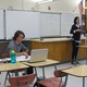 Senior Nate Obbard consults his notes as his sister, sophomore Julia Obbard, gives her speech in the policy debate category on Nov. 12 at Skyline High School. (Travis Barton/City Journals)