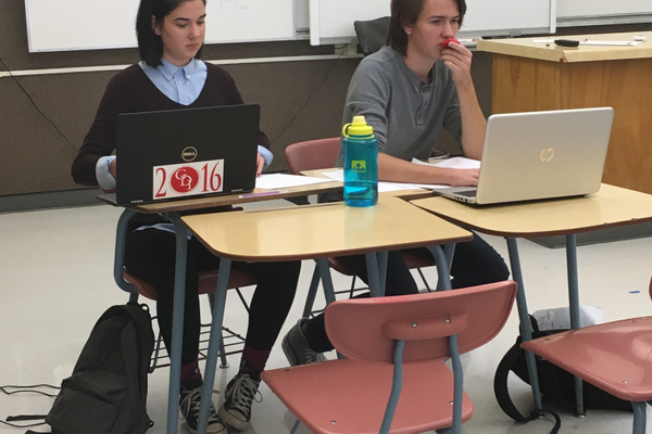 Sophomore Julia Obbard and senior Nate Obbard of the Highland High School debate team prepare before a round of competition at the Skyline High School on Nov. 12. The duo carried an 11 round winning streak into day two of the tournament. (Travis Barton/City Journals)
