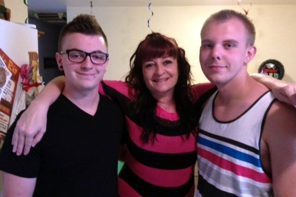 Cody Brotherson stands with his brother, Brayden, and his mother, Jenny. (Brotherson Family)