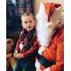 A boy sits on Santa's lap at the Historic Preservation Committee's 2015 Saturday with Santa event. Taylorsville Mayor Larry Johnson plays the part of Santa Claus. (Taylorsville City)