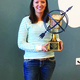 Jennifer Kesler, a history teacher at Eisenhower Junior High, poses with a trophy after the Utah Council for the Social Studies named her the Secondary Teacher of the Year at their mid-October conference.