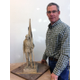 "Dan Snarr stands by the model he made prior to creating ""Proud,"" a 12-foot bronze sculpture. The original ""Proud"" statue was placed in Garden City, Utah, and Snarr hopes to bring a second casting to the Veterans Memorial Park in West Jordan."