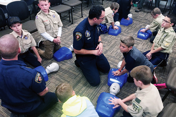 West Jordan firefighters teach Boy Scouts how to do CPR using dummies at one of their merit badge classes on Nov. 8. The department started offering merit badge classes as a service to the community in October. (Tori La Rue/City Journals)