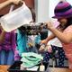 Stephanie Chazares and Cheyenne North test their rain shelter. (Jet Burnham/City Journals)