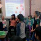 Third-graders inspect the tissue to see if the shelter successfully kept it dry. (Jet Burnham/City Journals)