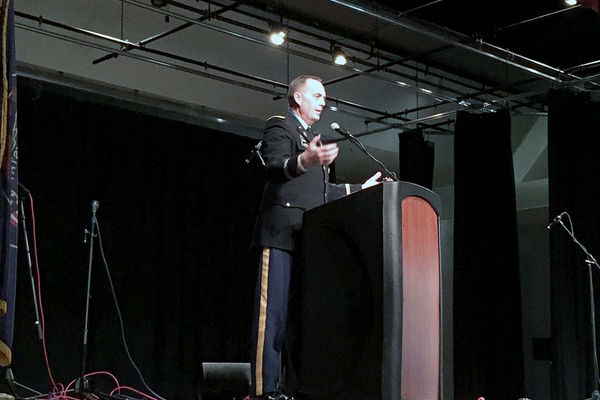 Lieutenant Colonel Gregg G. Lofgran addresses the crowd as the keynote speaker during the Veterans Day Program on Nov. 11 at the Utah Cultural Celebration Center. (Travis Barton/City Journals)