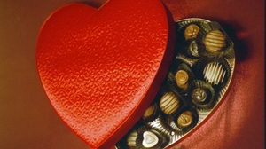 Medium hungry history celebrating valentines day with a box of chocolates istock 000000071357medium e