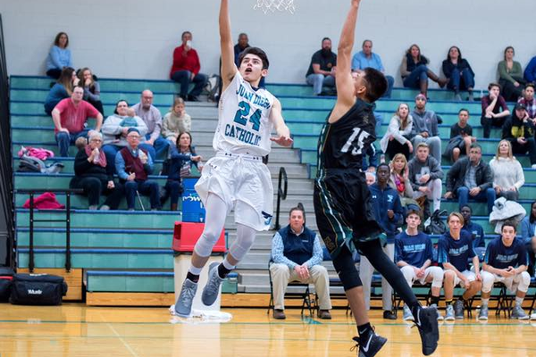 A Juan Diego player goes for a lay-up. (Juan Diego Catholic High School)Boys 1