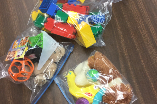 The students were asked to put their toys in gallon-sized ziplock bags for the kids in Guatemala. (Staci Rodriguez/ Highland Park)