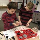 Ty Levesque and Spencer Call, both fifth-graders at Rose Creek Elementary school, organize a robotics kit during the school's first before-school robotics club meeting. Cammie Chang, a sixth-grade teacher at the school started the club after receiving a grant from Kihomac, a company that works to renew and extend aerospace investments. (Tori La Rue/City Journals)