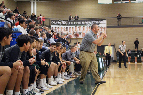 Head coach Sam Richins yells instructions to his team on Jan. 13 at Olympus High School. Richins is in his eighth year as head coach. (Travis Barton/City Journals)