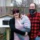 Jennifer and Ralph Simon stand with their son Tommy next to the Little Free Library outside of their home on Oliver Street in Bordentown City Staff photo by Samantha Sciarrotta