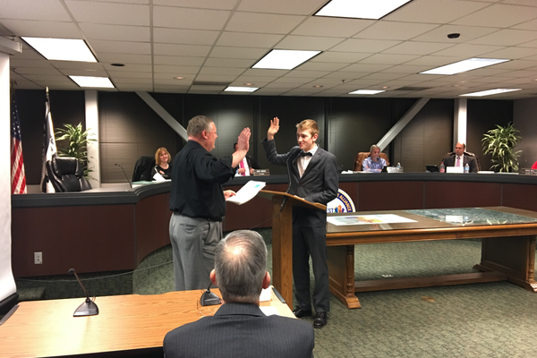 Aaron Dustin is sworn in as mayor of the South Salt Lake Youth Council. (Kelly Cannon/City Journals)
