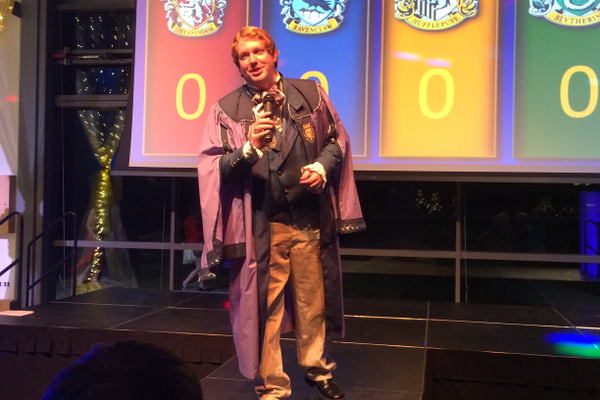 Gilderoy Lockhart addresses the crowd to begin the House Cup competition. (Marina McTee/City Journals)